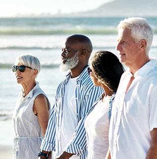Four seniors in a calm sea environment